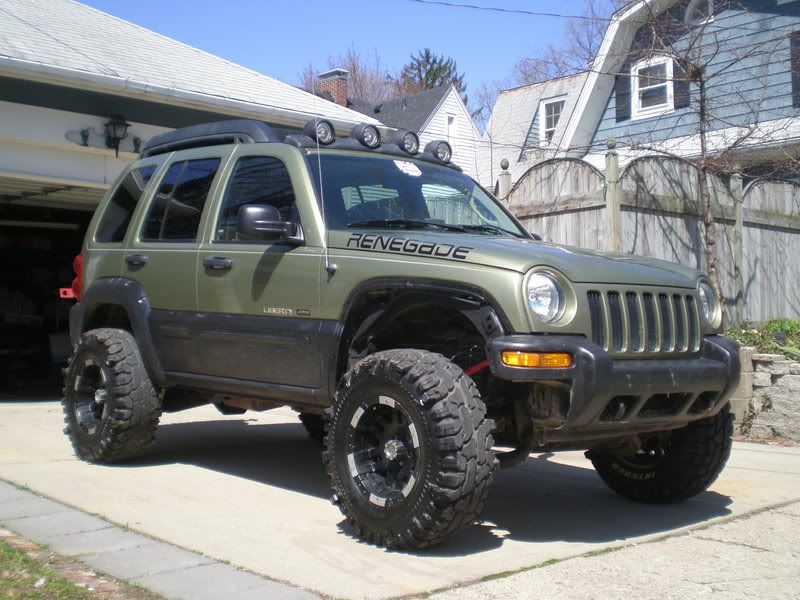 Lifted 2005 Liberty some updated pics of swmpthg 5.5