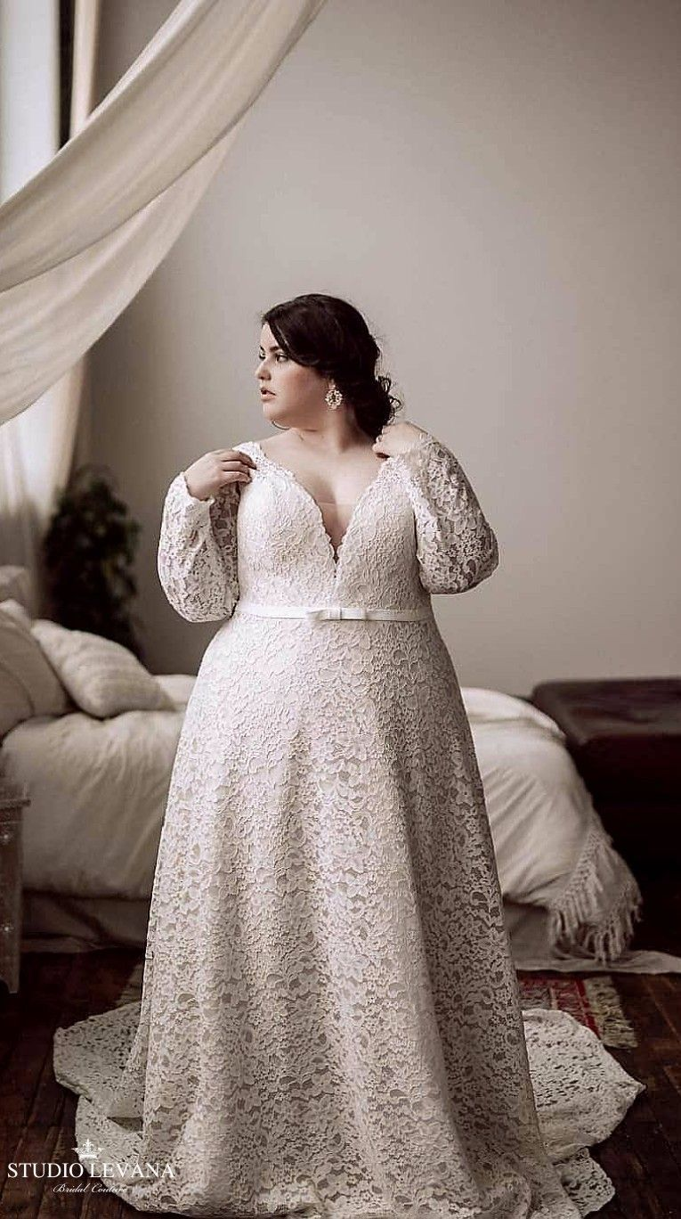 d5a1b60e7a2 Real plus size bride in a lace corset champagne wedding gown with long  sleeves. Seline. Studio Levana  weddinggowns