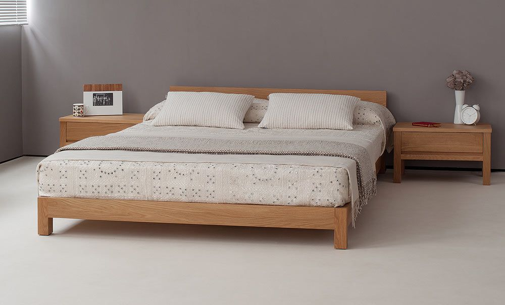 f0f61d63fe1 The Nevada low wooden bed in solid oak. Take a look at the website for