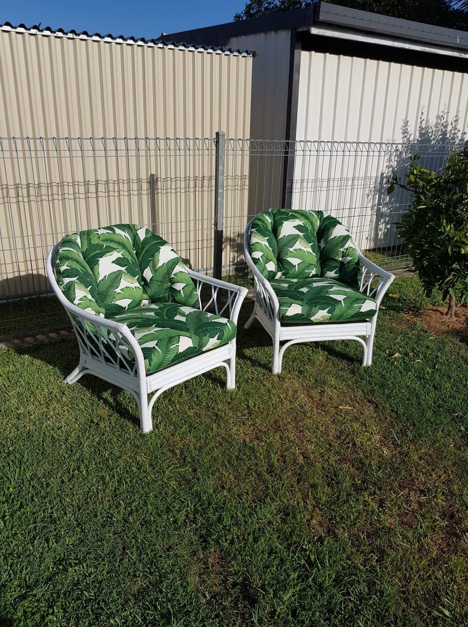 Vintage cane chairs painted white with new upholstery done in the original tommy bahamas fabric