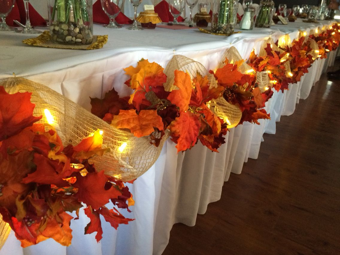 Fall wedding decor head table leaves burlap lights easy for Autumn wedding decoration ideas