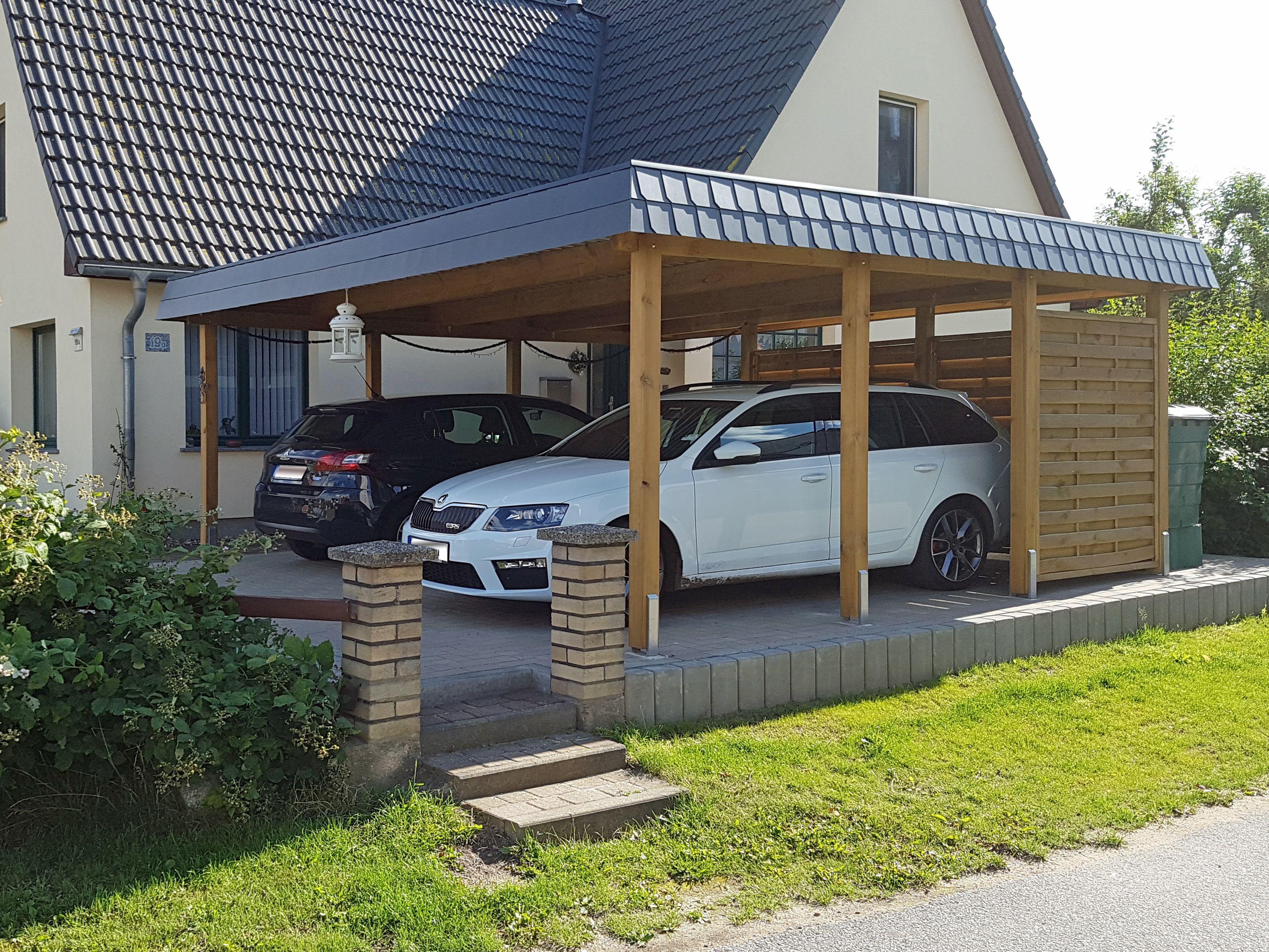 carport aus holz fr zwei pkw das dach ist mit einer zweireihigen schindelblende umlaufend verkleidet
