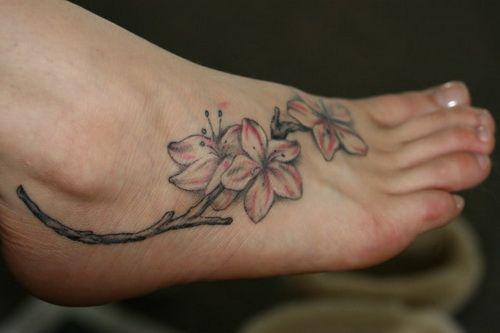 First Tattoo On Your Feet Tattoo Design And Ideas Vine Foot Tattoos Flower Foot Tattoo Apple Blossom Tattoos
