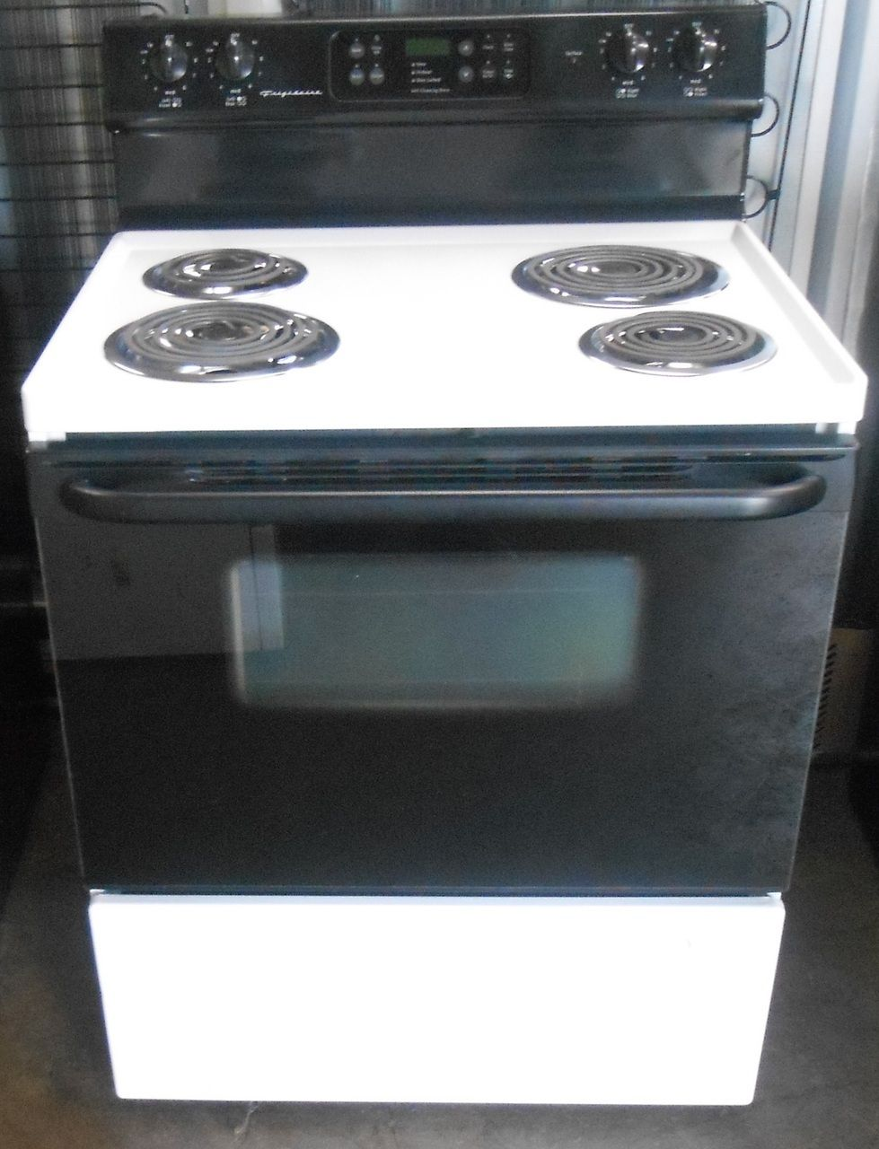 Appliance city frigidaire 30 inch self cleaning electric range appliance city frigidaire 30 inch self cleaning electric range coil burners 2 large 2 small time bake option black glass oven door with window storage eventelaan Gallery