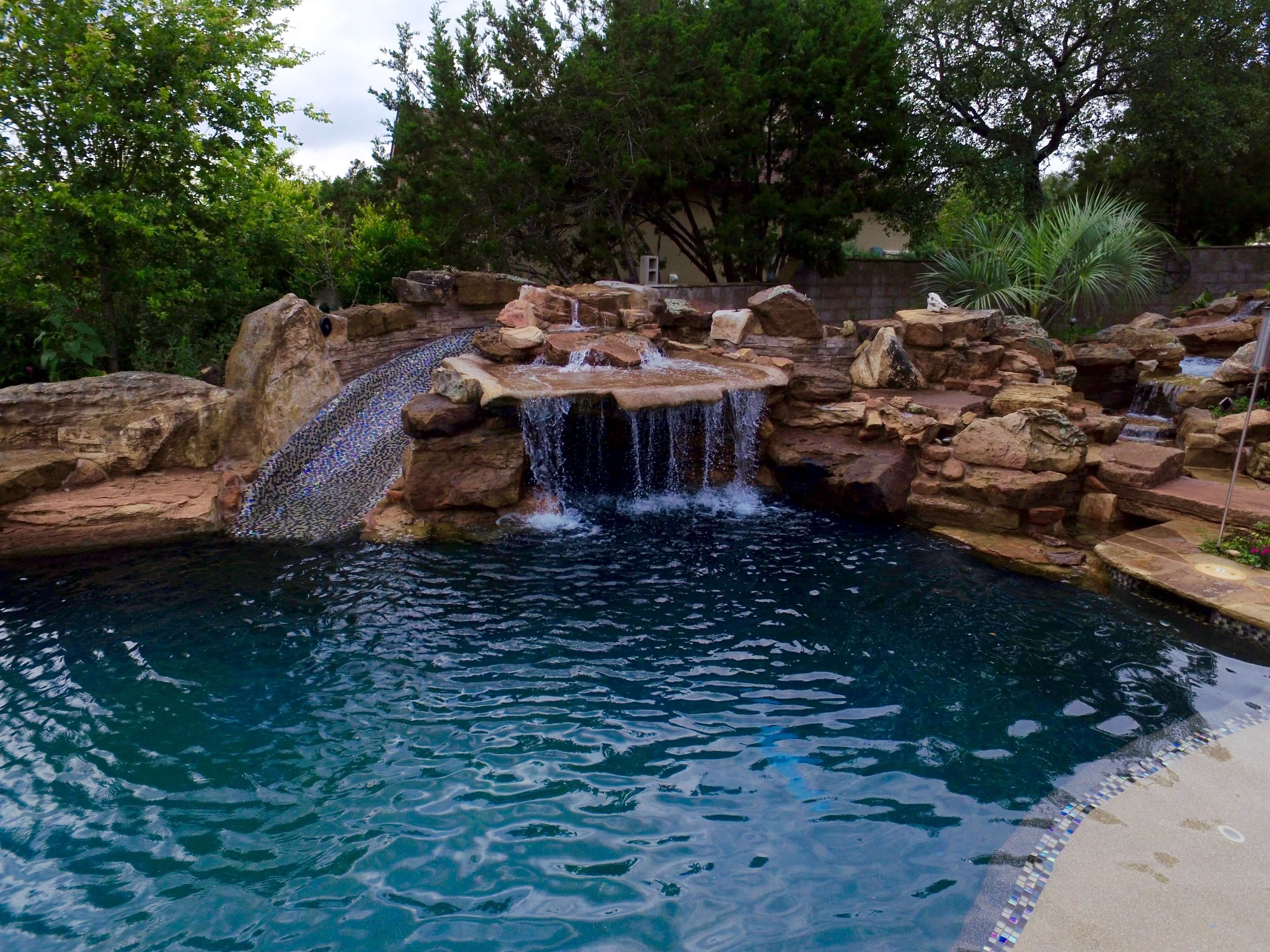 Water Features Spring Branch Fire Woks Boerne New Braunfels Grotto Waterfall With Cave Lar Backyard Pool Landscaping Pool Landscaping Pool Water Features