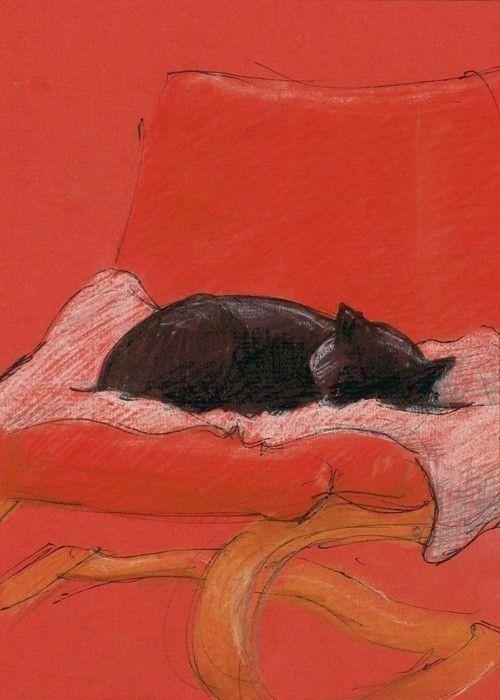 Gatito negro en sillon rojo
