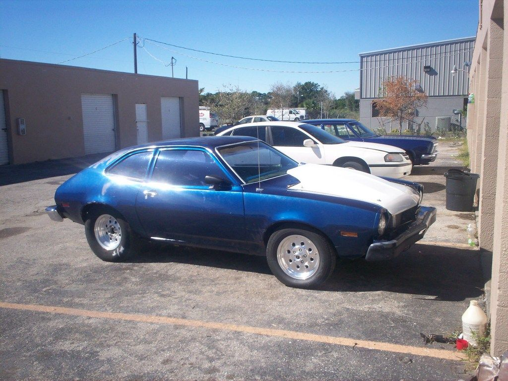 My first vehicle....Ford Pinto.  I remember finding it up on the school lawn one day. (Lifted there by school friends as a joke.)