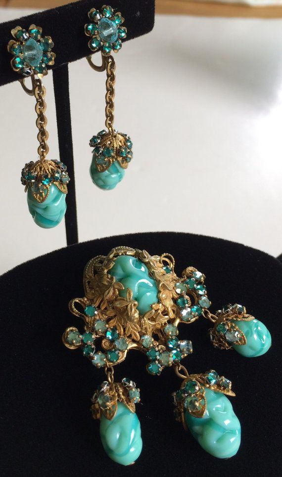 Here is a spectacular vintage brooch and earrings set by designer Miriam Haskell. This jewelry is superbly crafted with exceptionally