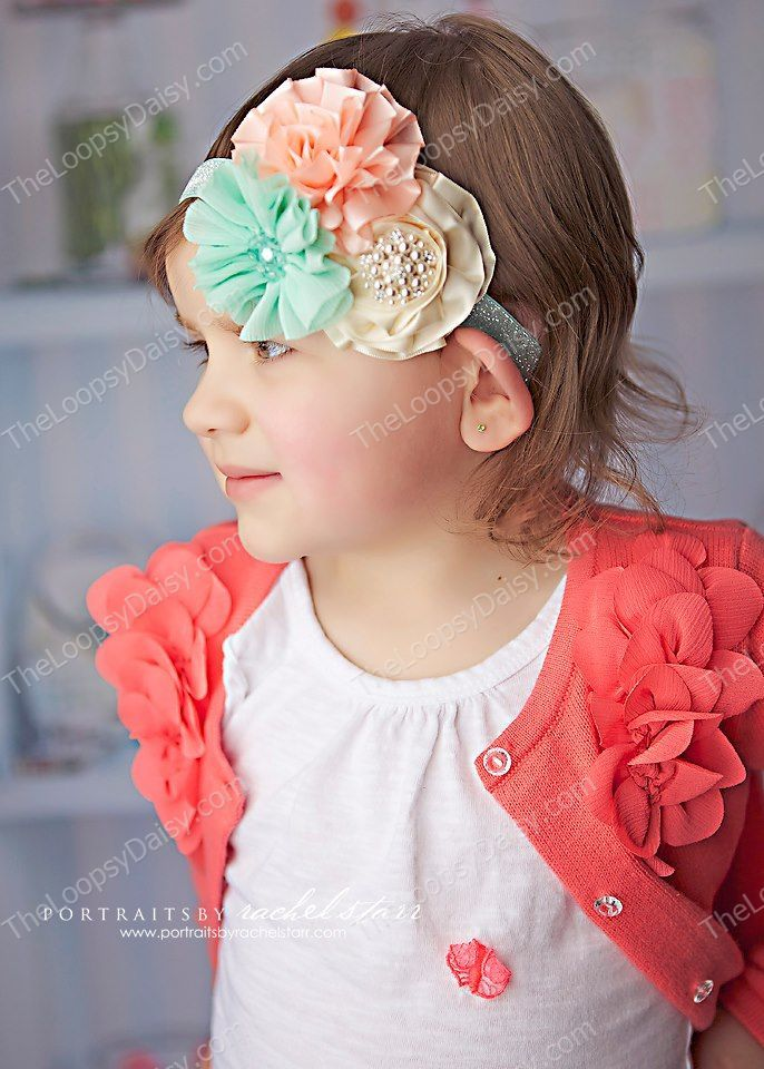 Sweet Indulgence Headband Soft and sweet coral, aqua and cream colored blooms mounted on a beautiful shimm...