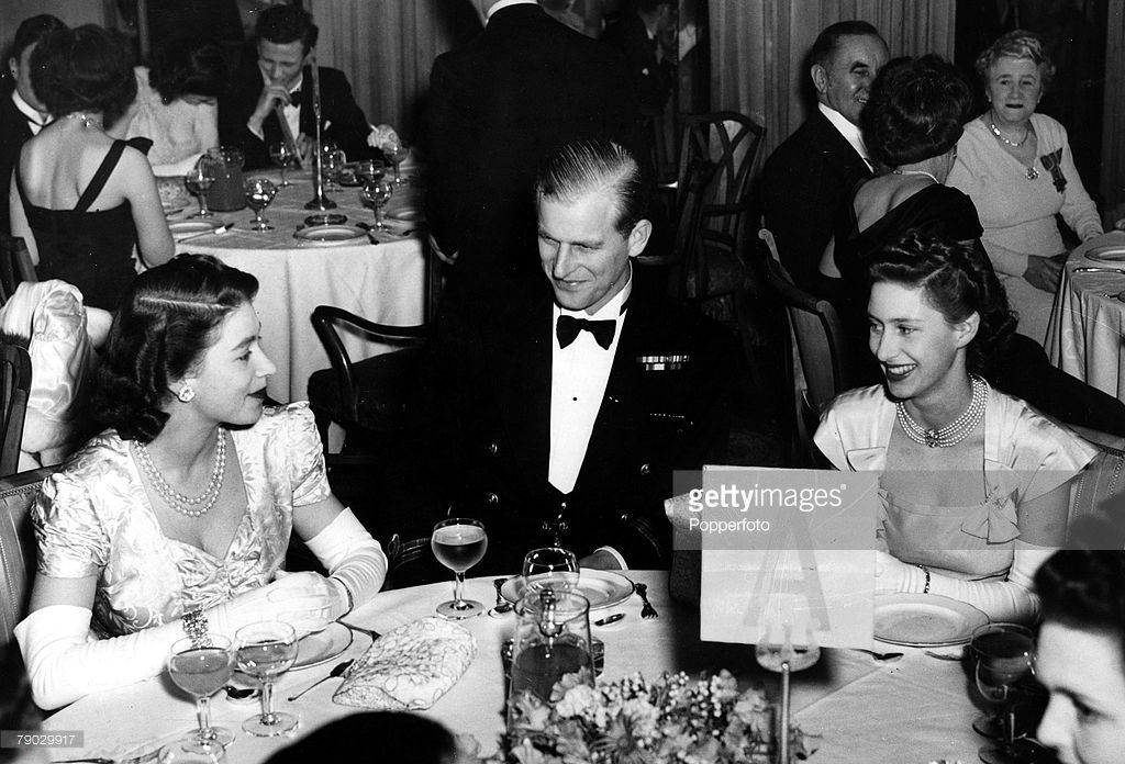 London, England, 5th May 1948, Princess Elizabeth, the Duke of Edinburgh and Princess Margaret sit for supper when they attended the Charity Ball held in aid of King George V Sailor fund at the Dorchester Hotel (Photo by Popperfoto/Getty Images)