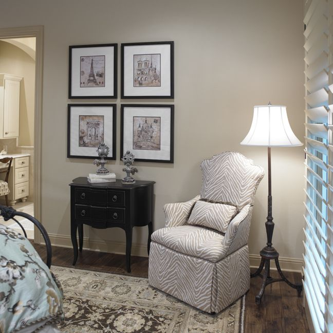 bedroom but petite chair floor lamp frames side tableand a touch of blue on the bed linens