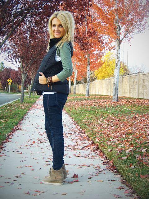 fleece vest, green long-sleeved tee, layered white tank, wedge sneakers