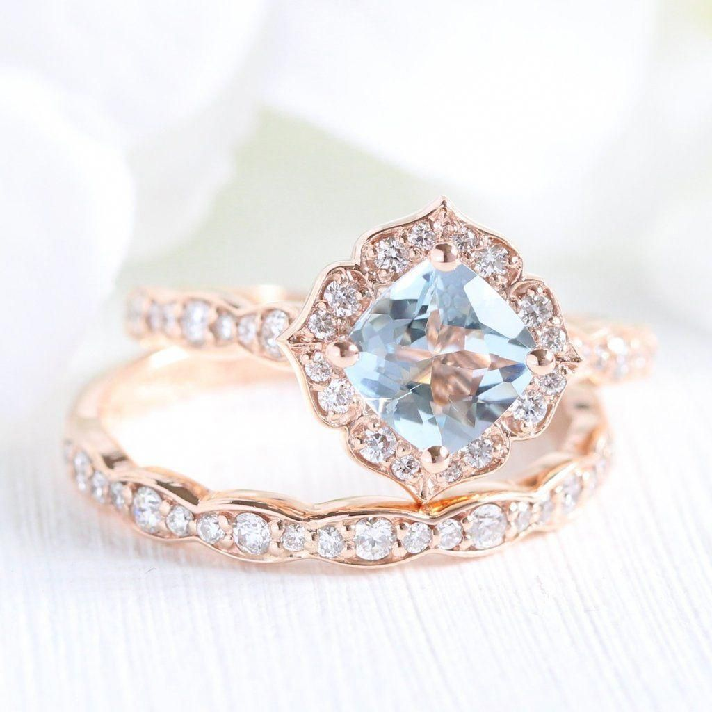 This Unique Bridal Ring Set Showcases A Vintage Floral Aquamarine Engagement Ring And Matchin Wedding Rings Unique Wedding Rings Vintage Floral Engagement Ring