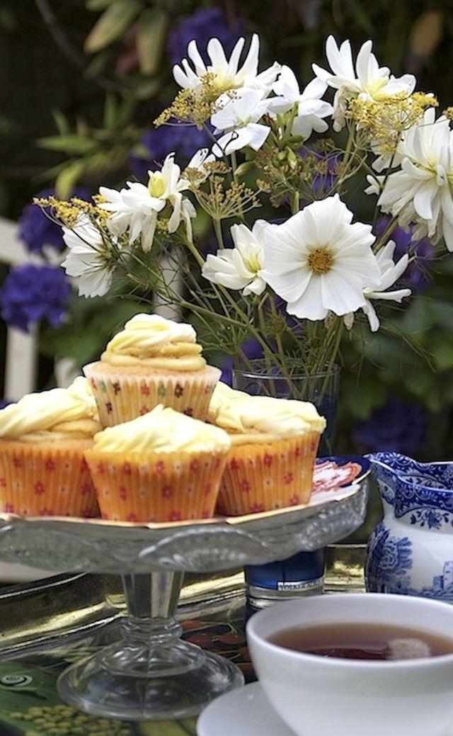Summer afternoon tea. Lemon curd cupcakes in the garden.