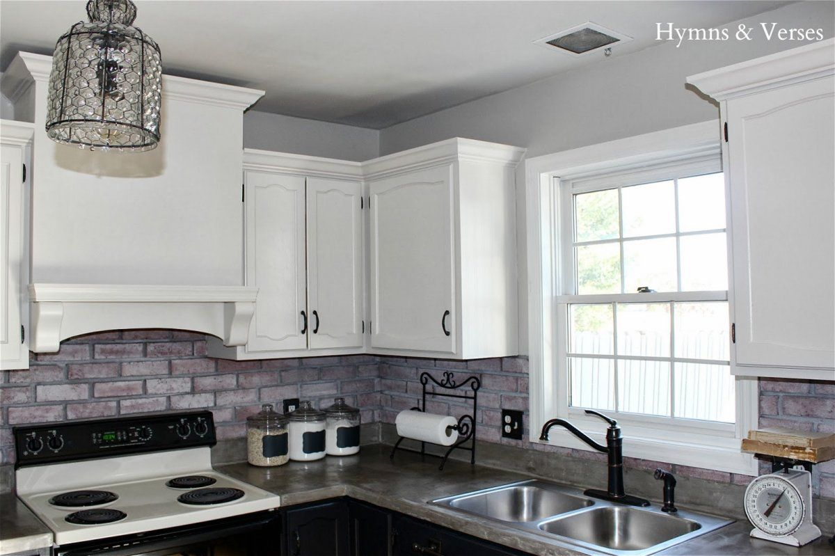 Contemporary Kitchen with Red White Faux Brick Subway Tile ...