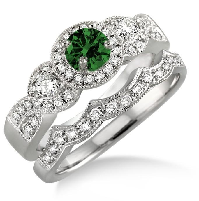1.5 Carat Emerald & Diamond Halo Bridal Set on 10k White Gold. The vintage Emerald and diamond bridal wedding ring set for woman is now available at sale price for limited time. The order comes with free shipping. Give her the perfect Emerald and diamond engagement ring set.| Price: $699.00 USD on Shygems