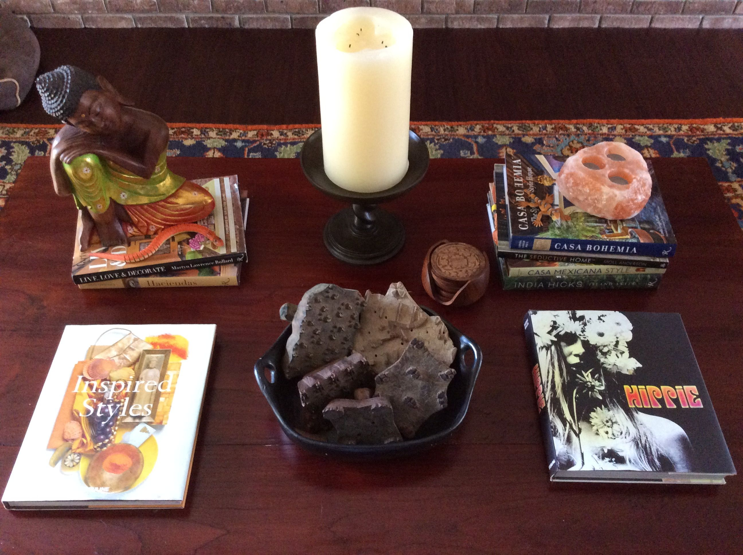 Current coffee table vignette in the Den l because of a Buddha