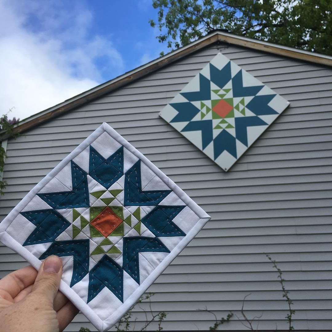 "A year ago I made a 4' x 4' barn quilt for our garage. Now I have a 6""x 6"" version of it! Those 1/2"" half square triangles make me squeal! #mmminimini #miniquilt #ittybittypieces #barnquilt #handquilted @makemodernmagazine"