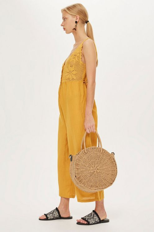 61a6b665df7 This cropped wide fit jumpsuit features crochet detailing and button  through fastening. We love the summer-ready mustard tone and the  exaggerated cut.
