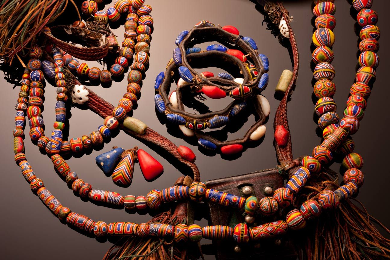 A collection of Kiffa bead related items, beads, bracelets, slave girl scapuler