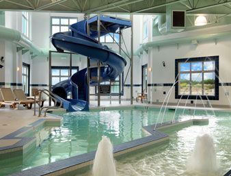 Home indoor pool and hot tub  Indoor Pool, Hot Tub And Waterslide at the Ramada Wainwright in ...