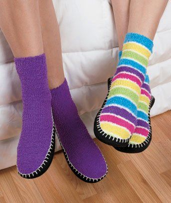 Slipper Socks - 2 Pairs - One Purple -One Rainbow Stripe - Extend above the ankle -dot grippers on Bottom - Women`s sock size 9 to 11 -Fits shoe sizes 6-10 -Machine Washable - Listing price: $39.95 Now: $21.95