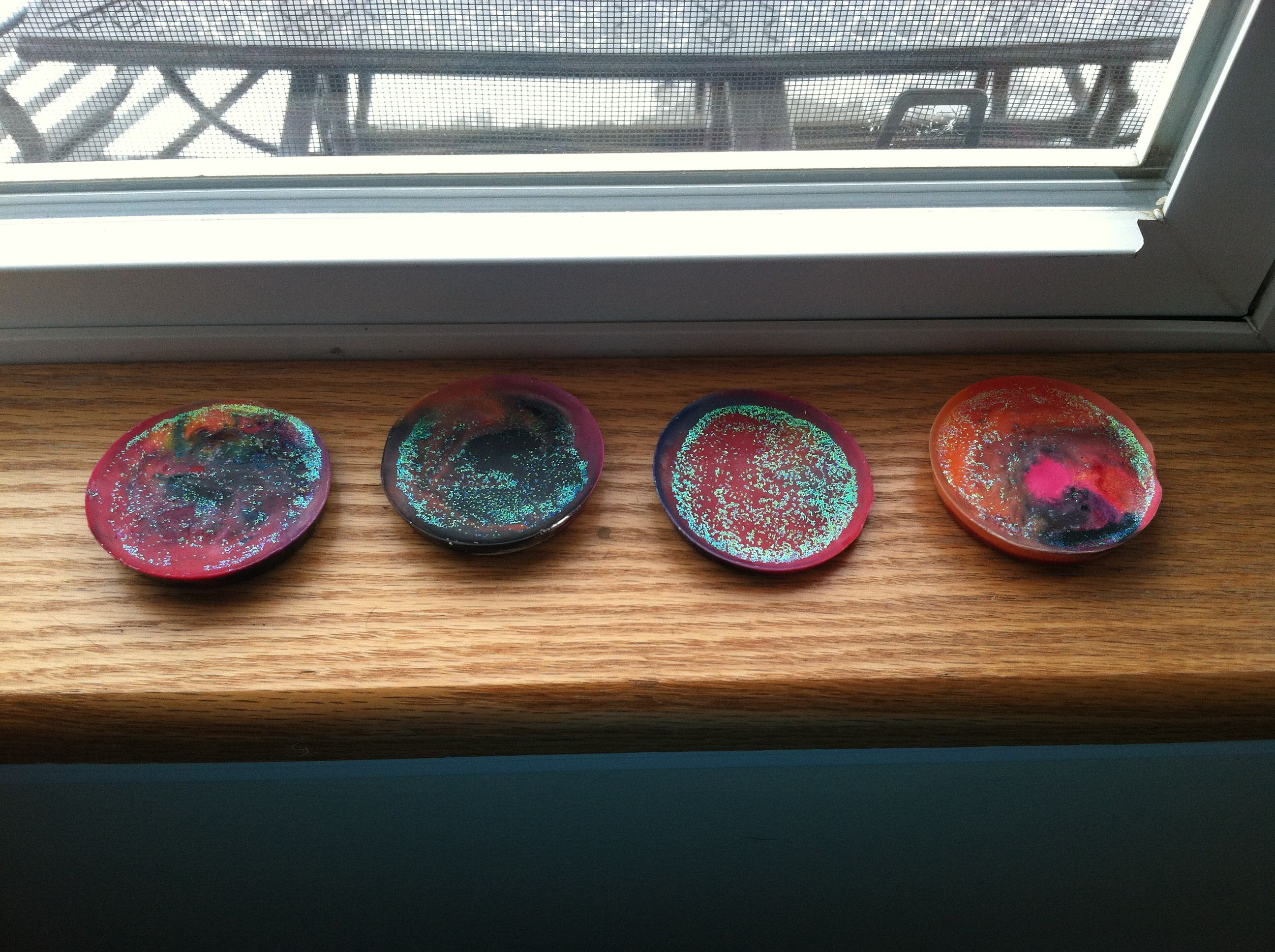 Homemade crayons! Break up crayons, and melt them with glitter in a muffin tin.