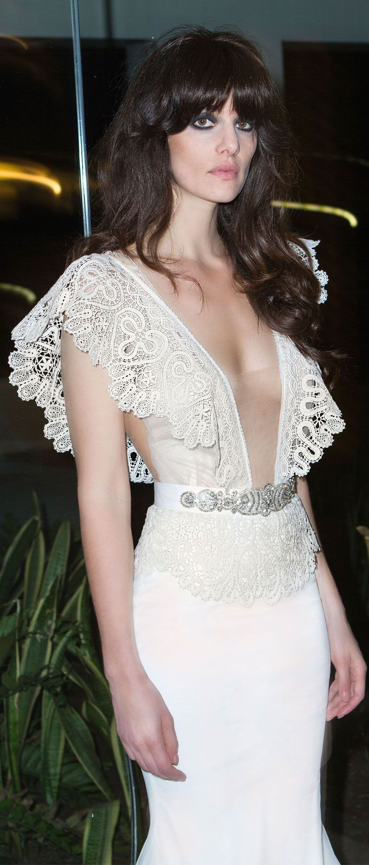 two piece wedding gown in Ivory color. special bobbin lace bodysuit, large shoulders details. mermaid cut tulle skirt. Fit and flare  wedding dress #weddingdress #weddinggown
