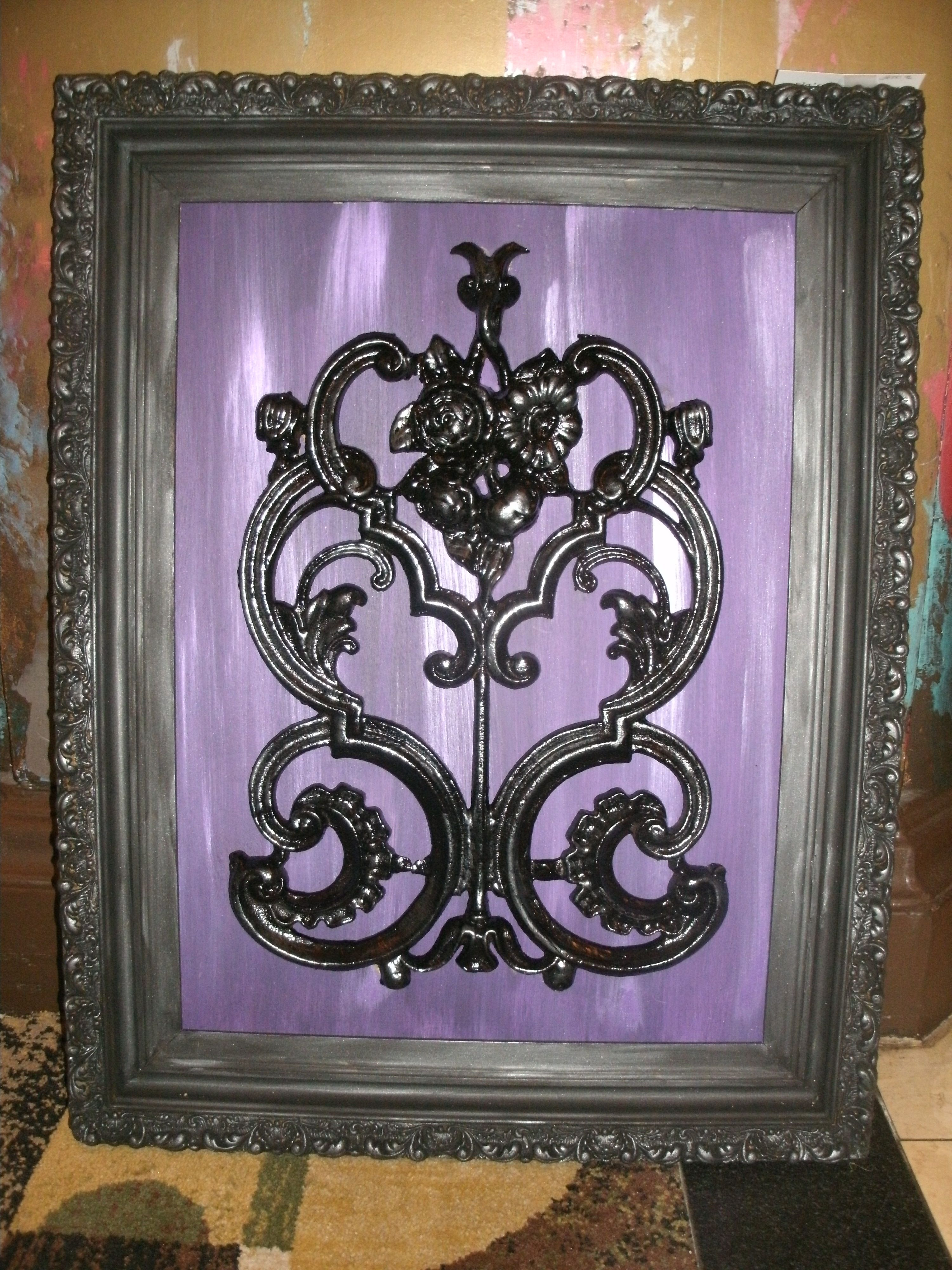 Old piece of Iron work mounted on a painted board and framed with vintage frame