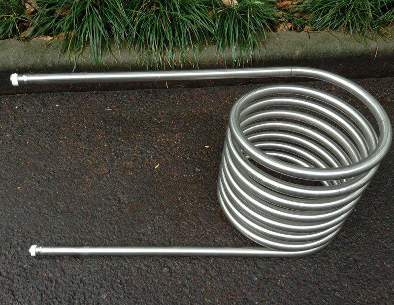 wooden fired hot tub coil heater help you enjoy hot bath outdoor.