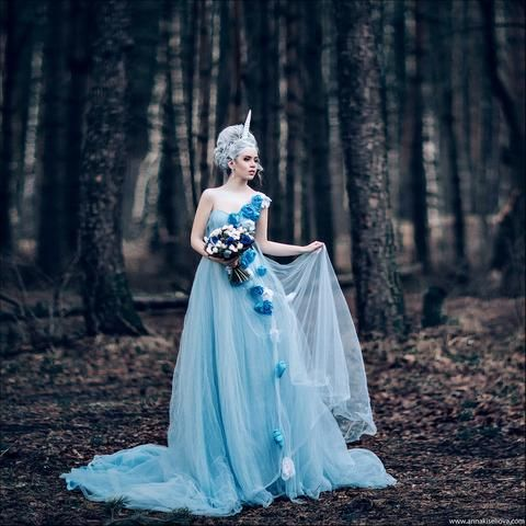 Beautiful Bride Wearing Light Blue Wedding Dress In A Lovely Forest Setting Love The Unicorn Horn As Well