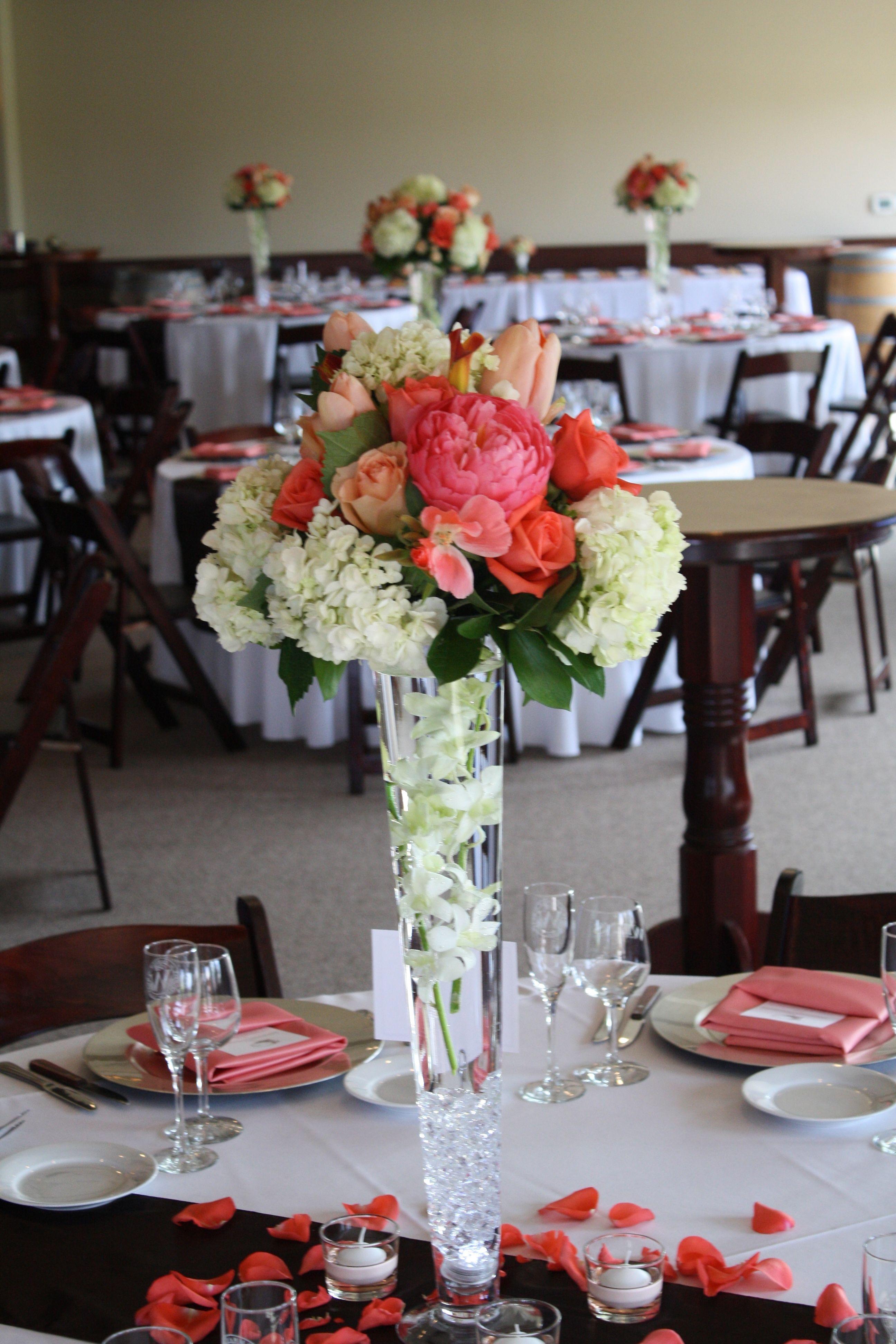 Centerpieces of white hydrangea coral peonys peach
