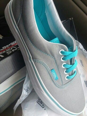 Grey and light blue Vans.   Town shoes