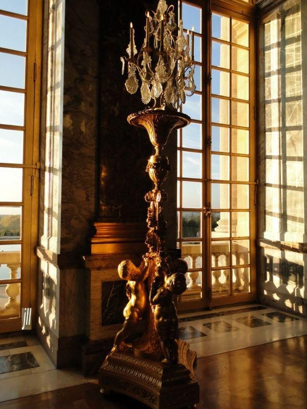 Afternoon light falling on the windows of the Hall of Mirrors — at Château de Versailles.