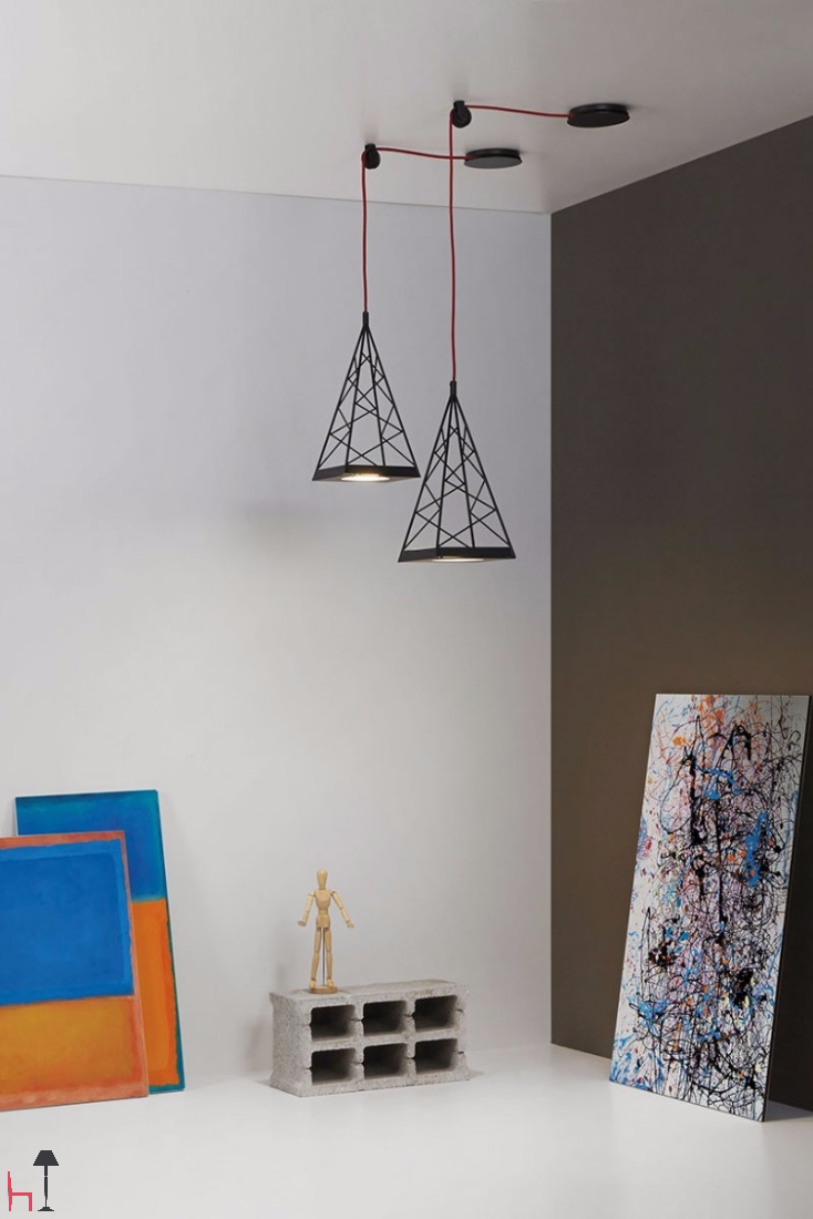 Pylon by Tooy is a pendant lamp that stands out for the iconic shape made of powder coated rod and metal sheet.