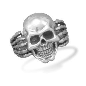 Oxidized sterling silver with skull and skeletal hands design. Skull area of ring is 23mm with a 10.5mm band. This ring is available in whole sizes 7-14. .925 Sterling Silver