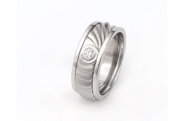 Gents ring with diamond accent that emulates the pattern of ripples in water. #ring #diamond #christopherduquet