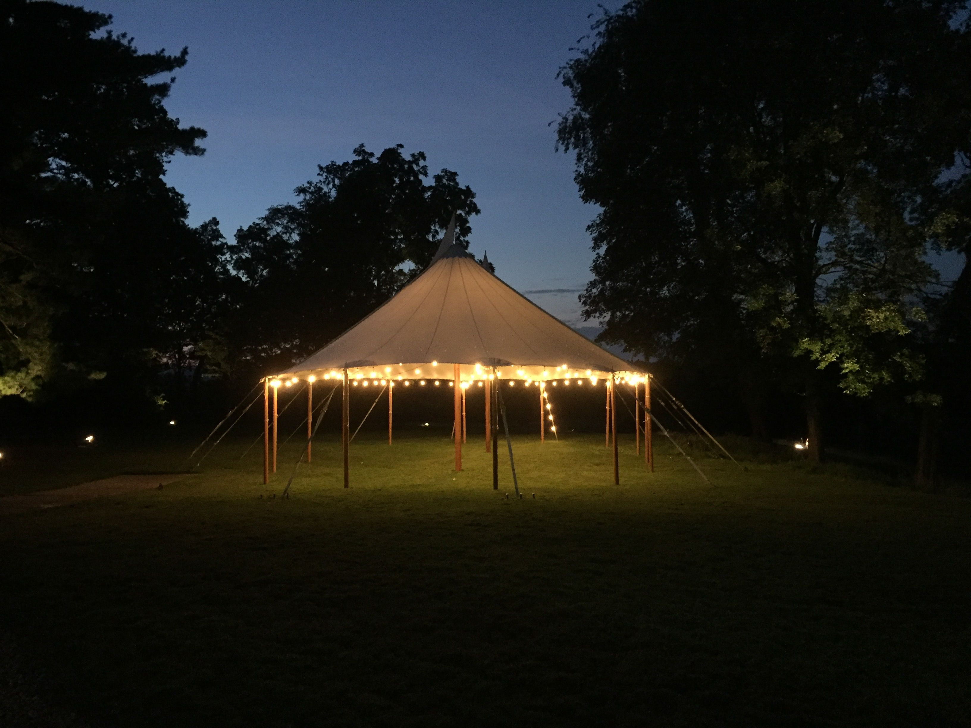 wow your guest with a sail cloth tent and bistro lighting tent