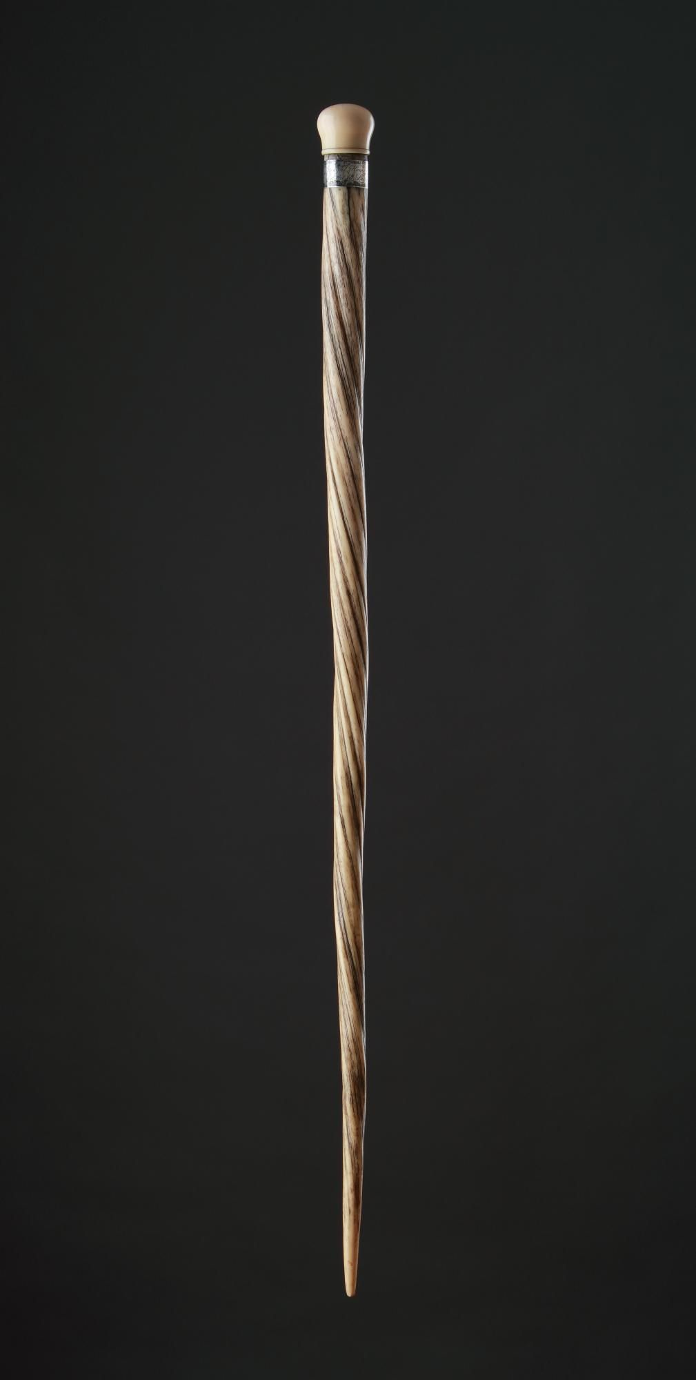 A highly important Narwhal Sailors' Cane with silver mounting and walrus ivory top that unscrews to form a small container for holding snuff etc. Being offered at auction on 20 May 2014, lot 118