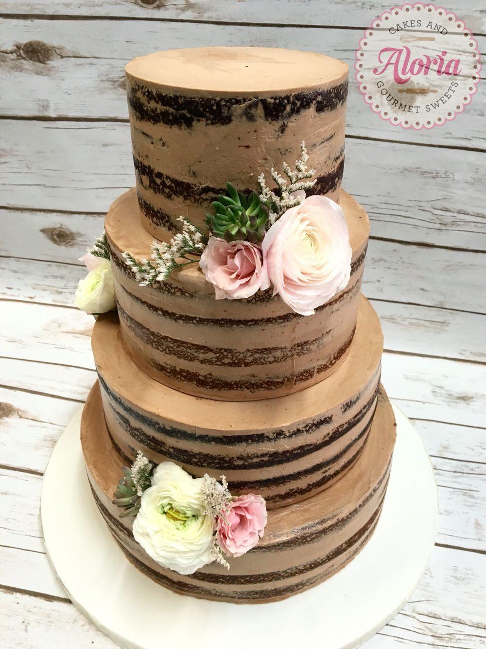 Wedding cake, naked cake with fresh flowers. Alternating chocolate and vanilla cakes, Nutella Swiss meringue buttercream.