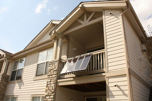 Solar Panels Installed On Apartment Balcony And Hooked Up To A Battery Run Tv Or