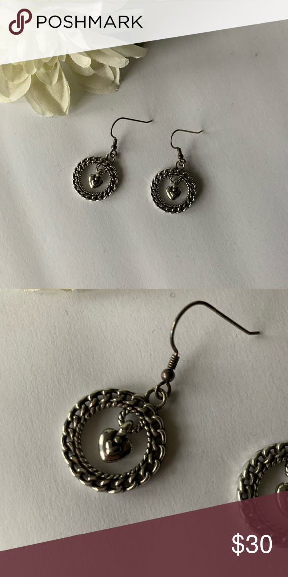 Brighton earrings Beautiful circle hang earrings with small heart that dangles in the middle. Great condition. Brighton Jewelry Earrings #woodyandbobeep