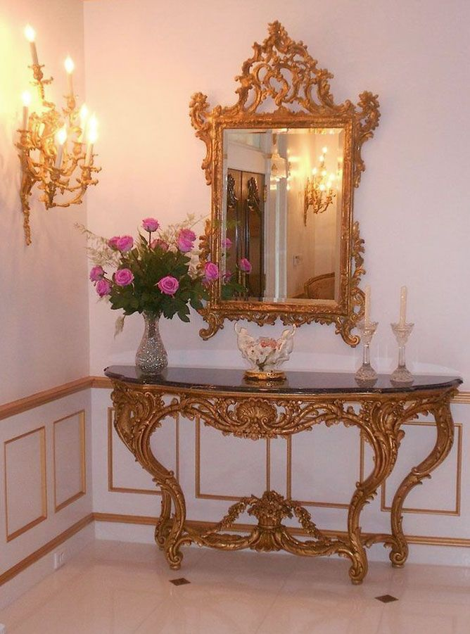 entry decor featuring louis xv style carved console in distressed