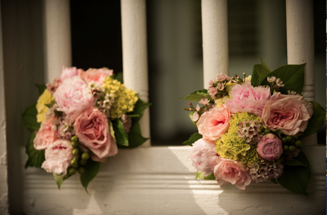 AK Brides - Wedding Planning Services - Bridesmaids bouquets tucked in the railing of this beach house porch. Thank you Jerrod Brown Studios of Birmingham AL