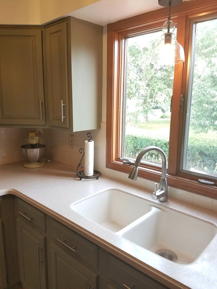 Annie Sloane Chateau Grey Paint On Cabinets, Simply White On Walls, Corian  Countertops, White Backsplash. Improving Your Kitchen Doesnu0027t Need To Cost  A ...