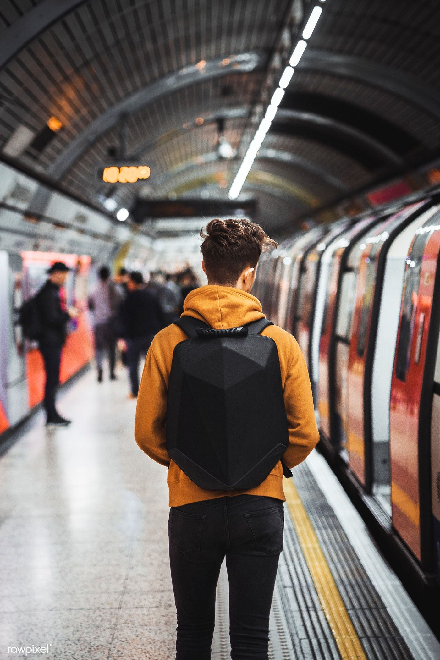Download Premium Image Of Man Walking Inside Of Underground Tube