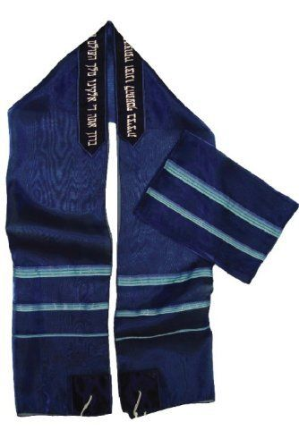"""Dark Blue ICE Cloth Tallit with Blue Stripes and Black Atara by World of Judaica. $146.00. This dark blue ICE cloth Tallit features turquoise stripes on the side, Tzitzit on the corners and Hebrew text embroidered in white into the Atara at the top. This dark blue """"?ICE"""" cloth Tallit is semi-transparent and decorated on the sides with three bands of turquoise and dark blue stripes. The Tallit features Tzitzit on the corners and has an Atara on the top edge that is black ..."""