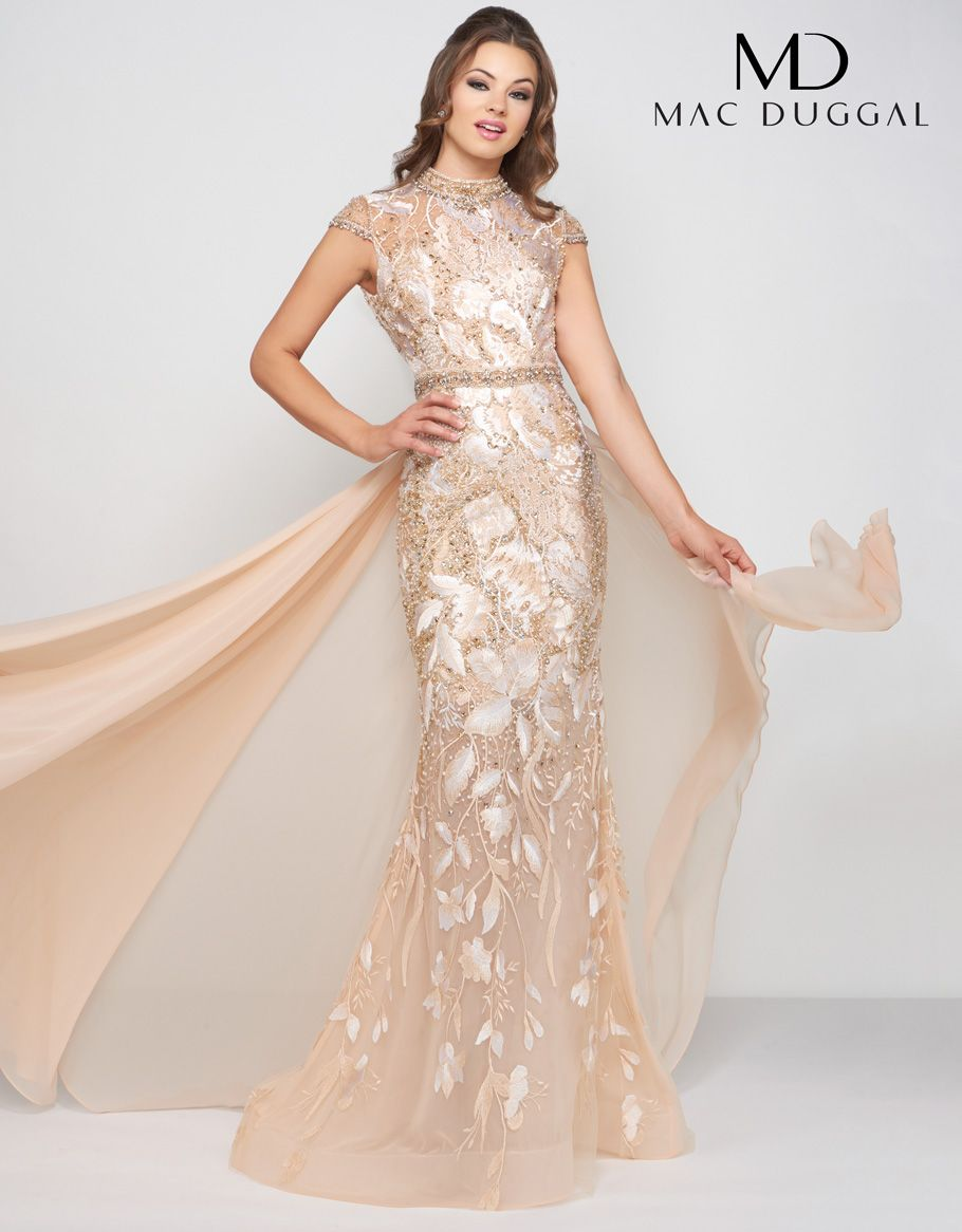 7666045992 Evening dress accented with crystal beading along the high neckline ...