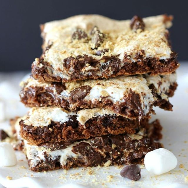 Pineapple Sunshine Cake Nutella S'mores Bars – the ultimate s'mores treat filled with Nutella, marshmallow creme, chocolate chips, and a dusting of graham cracker crumbs. . Get the recipe  if you make this recipe. .