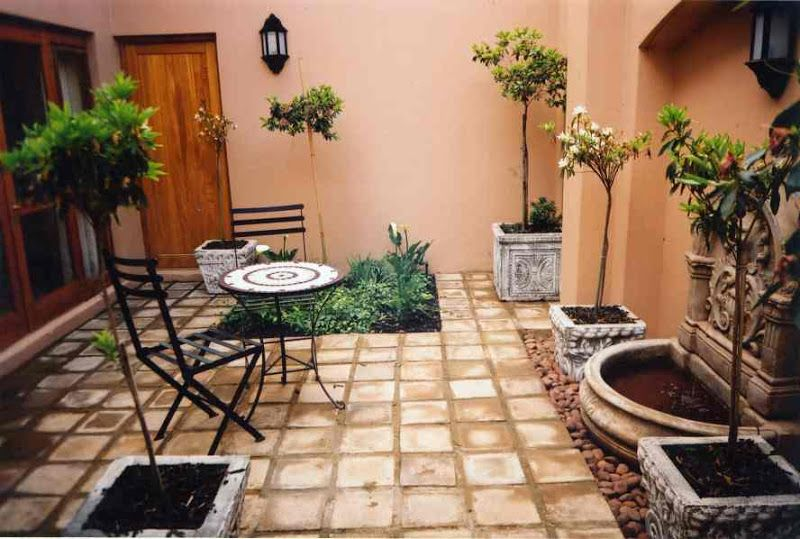Courtyard ideas on pinterest courtyards front yard for Courtyard landscaping ideas